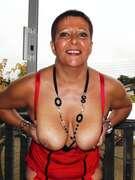 Photos des seins de Libido40, Guêpière rouge.